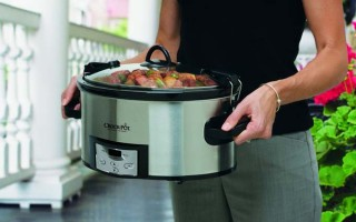 Crock-Pot SCCPVL610-S Programmable Cook and Carry Oval Slow Cooker by carried by female in black shirt and grey pants. Shows only torso and hands of woman with detail being centered on the crock pot.