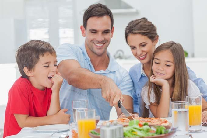 Family Enjoys a Homemade Pizza - Foodal.com