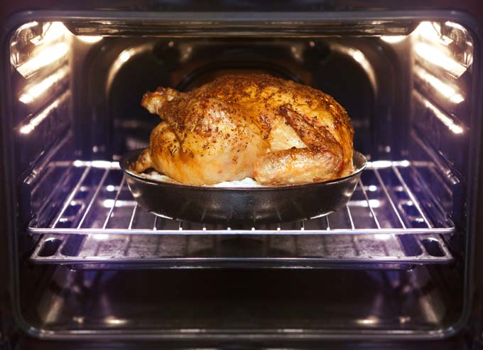Turkey is being baked in oven after brining | Foodal