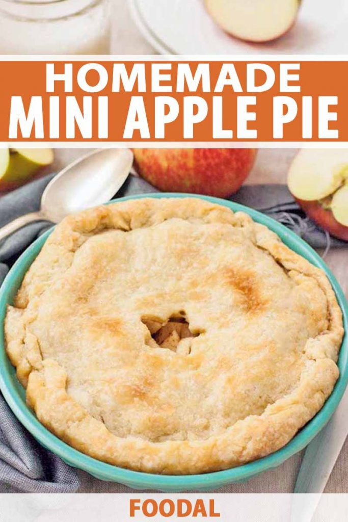 Apple pie with a star-shaped vent cut into the top crust, in an aqua baking dish, with several whole and sliced apples, a spoon, and a blue cloth, printed with orange and white text.