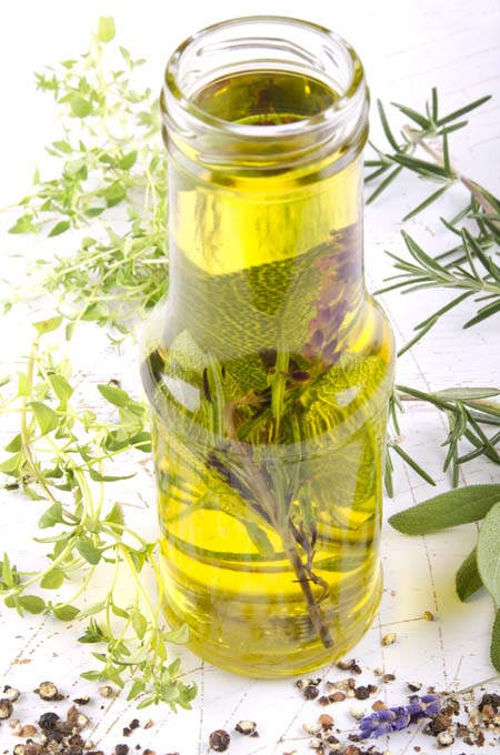 Steeping an mixture of herbs in oil | Foodal.com