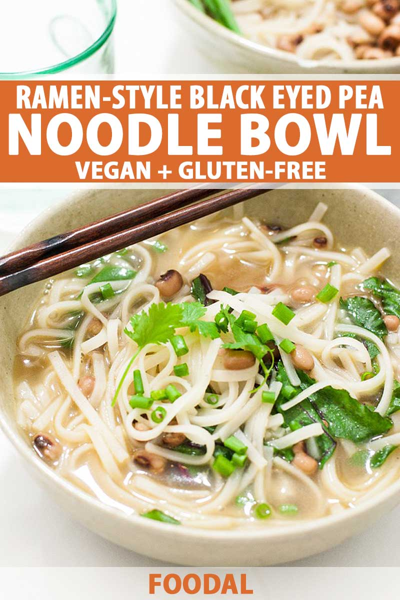 A close up of a white, ceramic bowl full of a vegan and gluten-free Ramen-Style Black Eyed Pea Noodle Bowl.