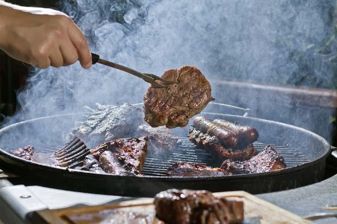 A smokey charcoal BBQ grill | Foodal.com