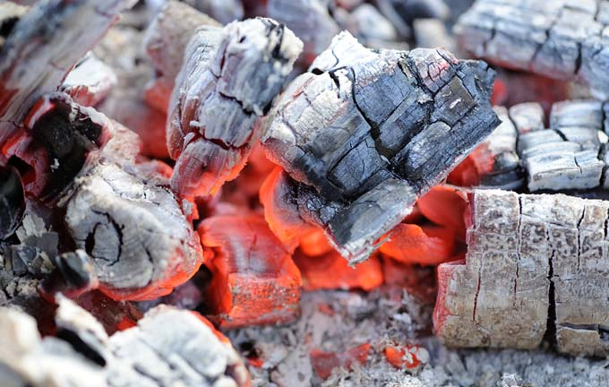 All wood, lump charcoal leave minimal residue and burns the hottest | Foodal.com