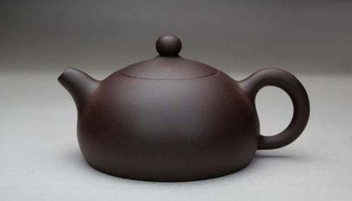 Chinese Yixing Purple Clay Handmade Half Moon Teapot | Foodal