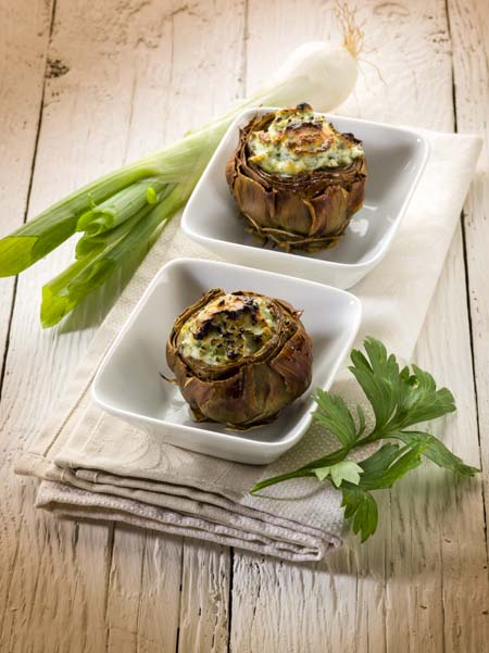 Artichoke stuffed with Italian sausage and stuffing mixture | Foodal.com