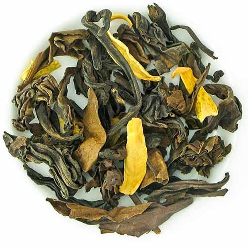 Orange blossom oolong loose leaf tea, isolated on a white background.