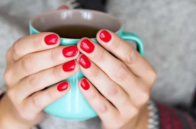 Hands Holding a Mug of Tea   Foodal.com