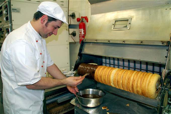 Baumkuchen being made in a commercial German bakery