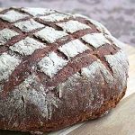 Freshly baked dark rye malted bread loaf. | Foodal.com