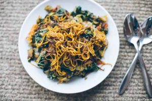 Spicy Peanut Kale Bowls Topped With Shoestring Sweet Potato Fries