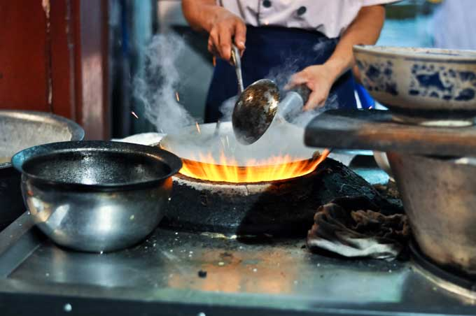 How To Use A Wok For Stir Frying Amp Steaming Foodal