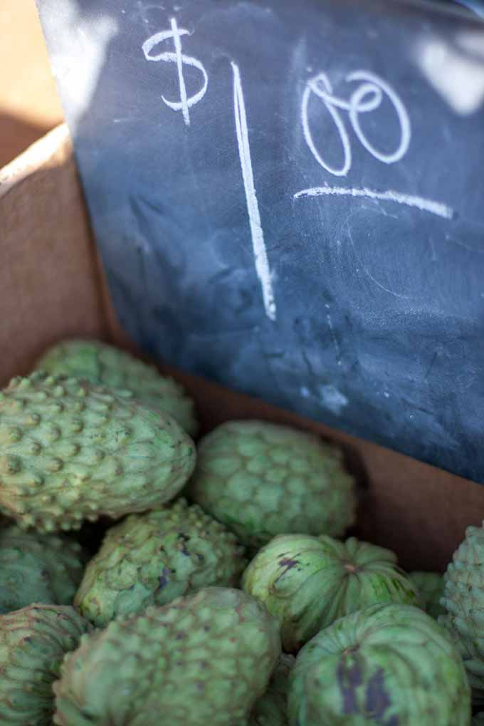 A box of cherimoya fruit at a Southern California farmers market.