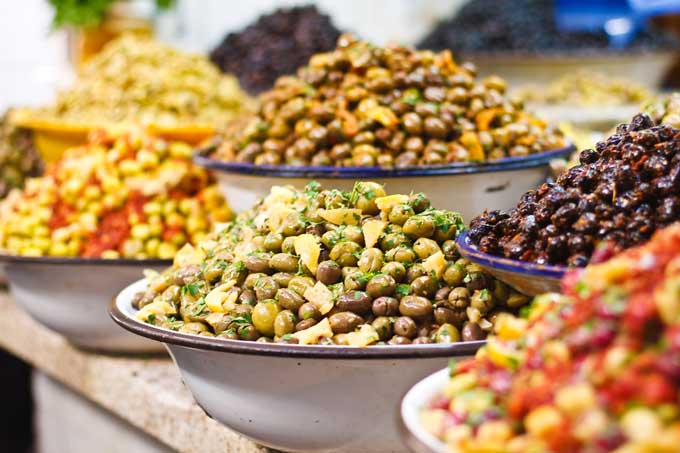 Different types and colors of olives at a Moroccan Market | Foodal.com