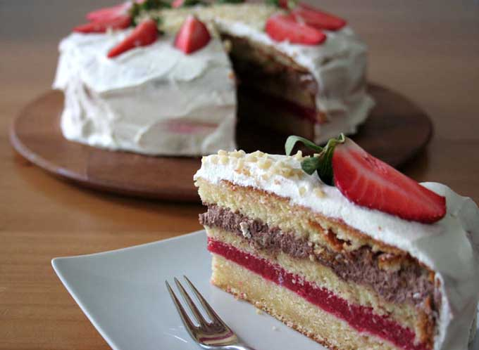 A strawberry layer cake for spring. Don't miss it! http://foodal.com/recipes/desserts/make-an-impression-with-this-festive-strawberry-layer-cake/