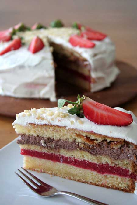 Chocolate and vanilla layers mix with a section of fresh strawberry puree making this one cake that you don't want to miss! http://foodal.com/recipes/desserts/make-an-impression-with-this-festive-strawberry-layer-cake/