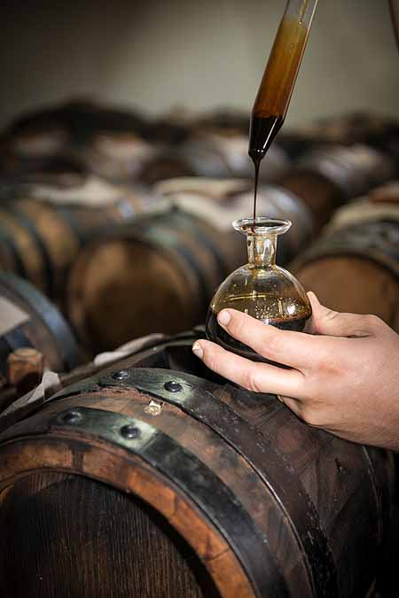 Italian balsamic vinegar aging in wooden barrels | Foodal.com