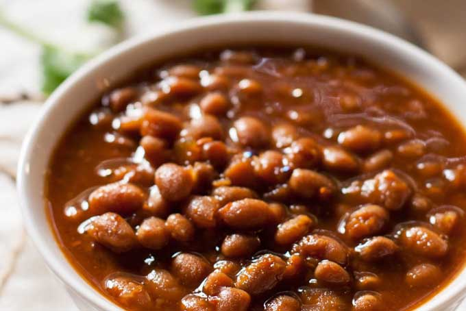 Very close up view of a bowl full of Vegetarian Slow Cooker Baked Bean.