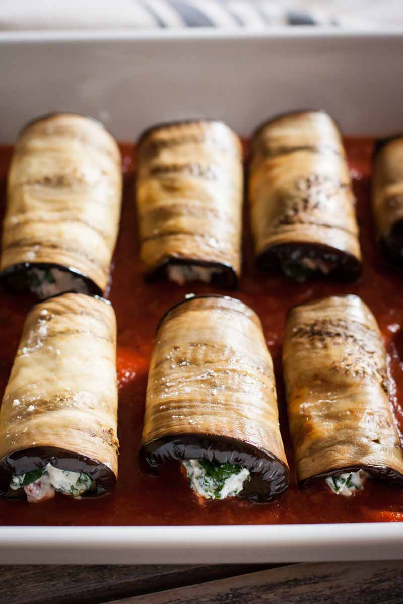 Close up of Eggplant, Kale & Ricotta Cannelloni rolls.