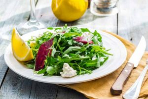 Fresh Green Salad with Arugula, Beets, Goat Cheese, and Olive Oil
