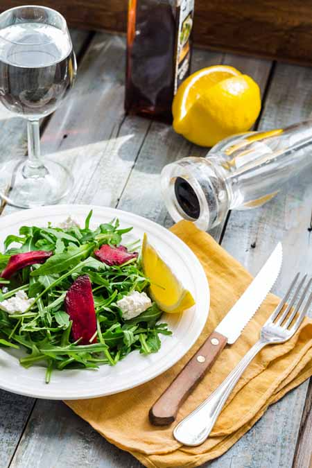 Fresh Green Salad with Arugula, Beets, Goat Cheese, and Olive Oil Recipe | Foodal.com