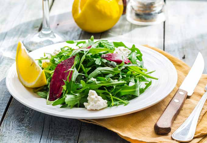 Fresh Green Salad with Arugula, Beets, Goat Cheese, and Olive Oil | Foodal.com