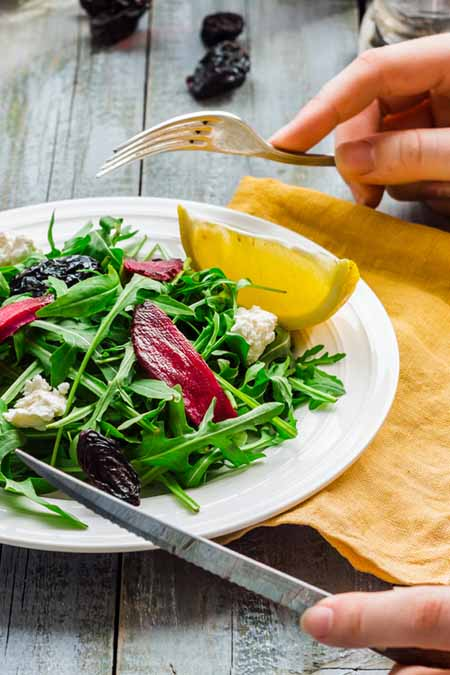Recipe for Fresh Green Salad with Arugula, Beets, Goat Cheese, and Olive Oil | Foodal.com