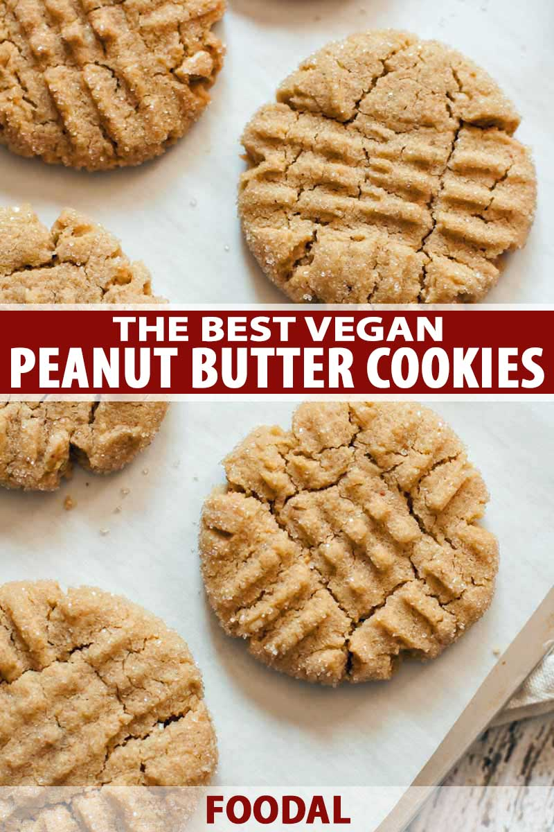 Top down view of five vegan peanut butter cookies on a baking tray