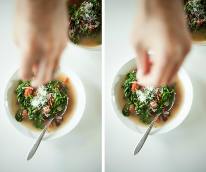 Italian-style beans and greens soup garnished with Parmesan
