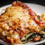 A close up of a piece of cheesy vegetarian lasagna.