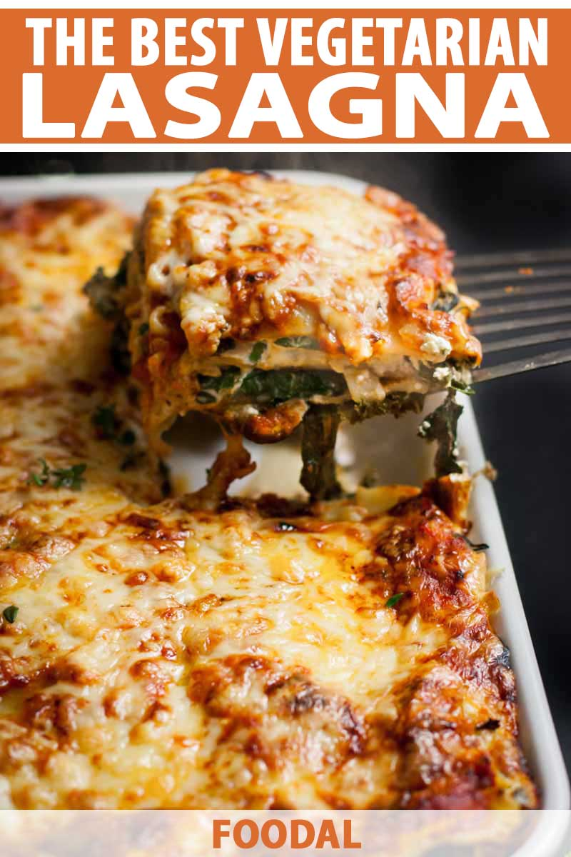 A spatula removes a portion of cheesy vegetarian lasagna from a casserole dish.
