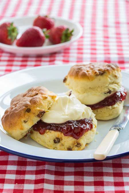 Clotted cream and strawberry jam on scones   Foodal.com