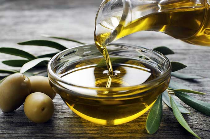 olive oil with branch | Foodal.com