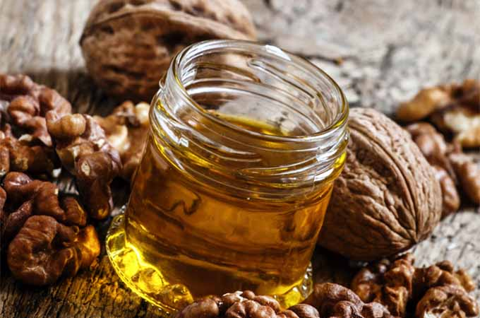 walnut oil with walnuts | Foodal.com