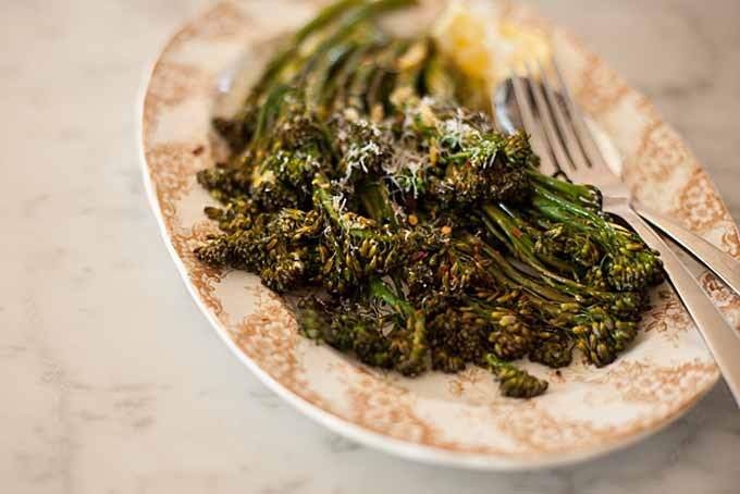 Top down view of a dish made of Roasted Baby Broccoli with Chili, Lemon and Dill.
