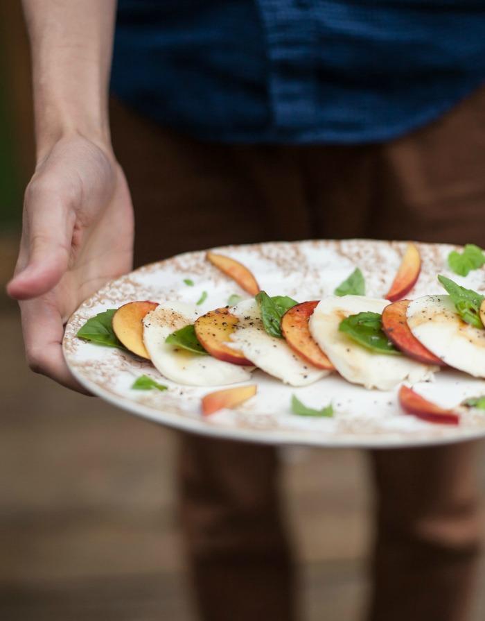 peach caprese salad on platter