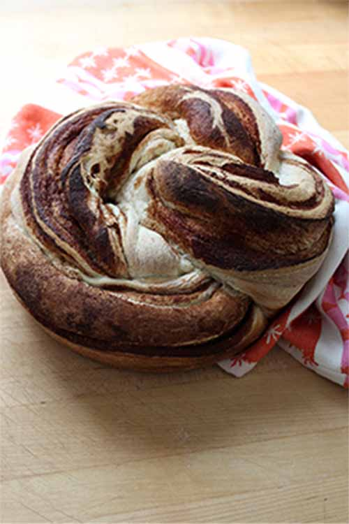 Learn how to make this tasty breakfast bread at home. Get the recipe now on Foodal: https://foodal.com/recipes/breads/twisted-cinnamon-cardamom-loaf/