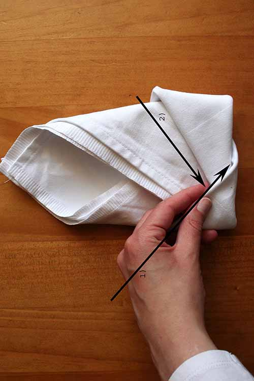 A pretty table setting isn't complete without a beautifully folded cloth napkin. Learn more about this (almost) lost art here on Foodal: https://foodal.com/knowledge/how-to/napkin-folding/