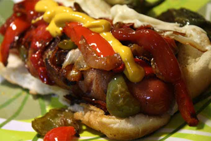 LA Street Dogs topped with peppers, onions, ketchup, and mustard.