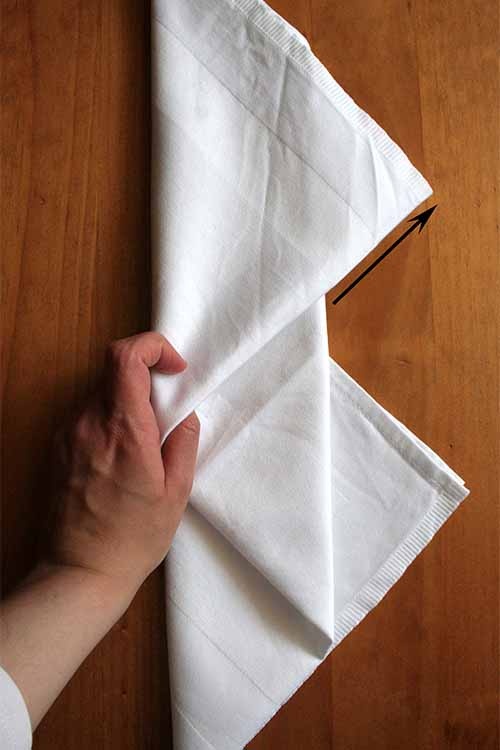 Learn to fold cloth napkins artistically with ease, with these simple steps. Learn more on Foodal: https://foodal.com/knowledge/how-to/napkin-folding/