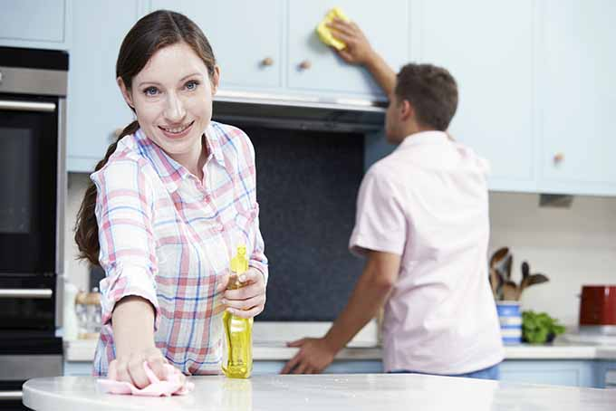 Man and Woman Clean the Kitchen