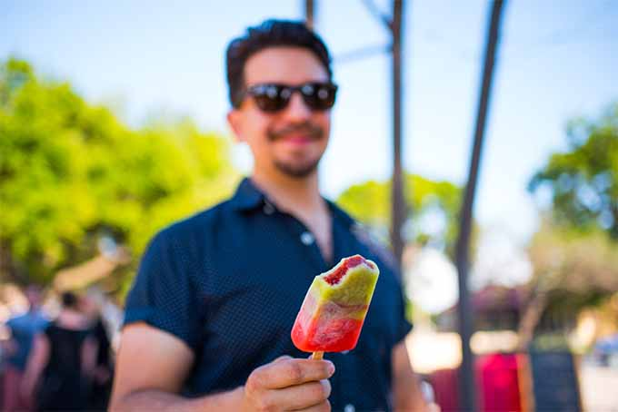 Man Enjoying a Fruit-Flavored Paleta | Foodal.com