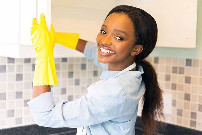 Smiling As She Cleans The Cabinets | Foodal.com