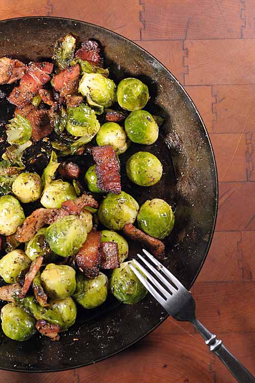 Brussels sprouts are huge source of antioxidants, folic acid, vitamins A, K, and C and other goodies. Add some bacon so it's palatable and that fat will also help the body to absorb all of that nutrient goodness. Get the recipe now: https://foodal.com/recipes/veggies/organic-brussels-sprouts-sauteed-with-bacon/