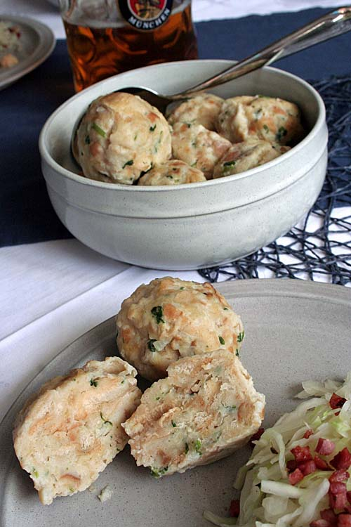 Use up day-old buns in these famous Southern German dumplings, and enjoy a versatile side dish with any savory meal! We share the recipe on Foodal. https://foodal.com/holidays/oktoberfest/german-bread-dumplings/