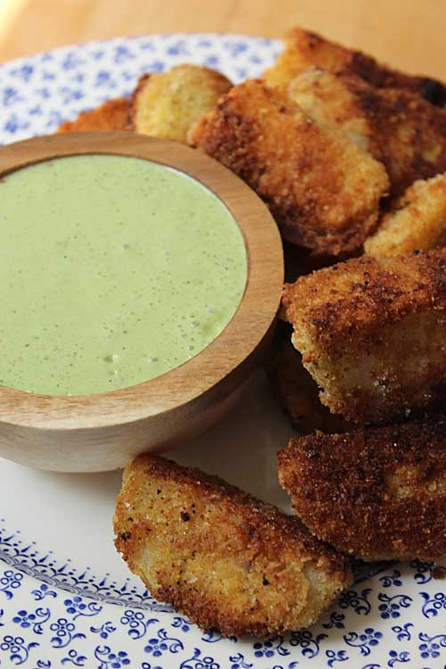 Tasty fried kohlrabi strips with cilantro yogurt dipping sauce will delight both kids and adults. Get the recipe for this amazing dish on Foodal now! https://foodal.com/recipes/appetizers/fried-kohlrabi/
