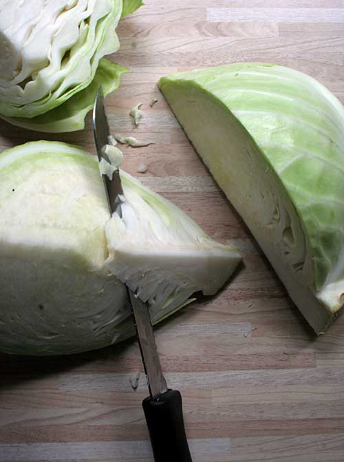 Step 1a of the Bavarian Cabbage Salad Recipe - Chopping and Quartering | Foodal.com
