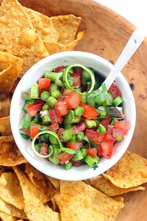 Don't do your tortilla chips a disservice by serving the canned stuff that's high in sodium and full of preservatives. It takes just a few minutes to whip up a batch of fresh salsa, made with seasonal produce: https://foodal.com/recipes/sauces/favorite-salsa-recipes/