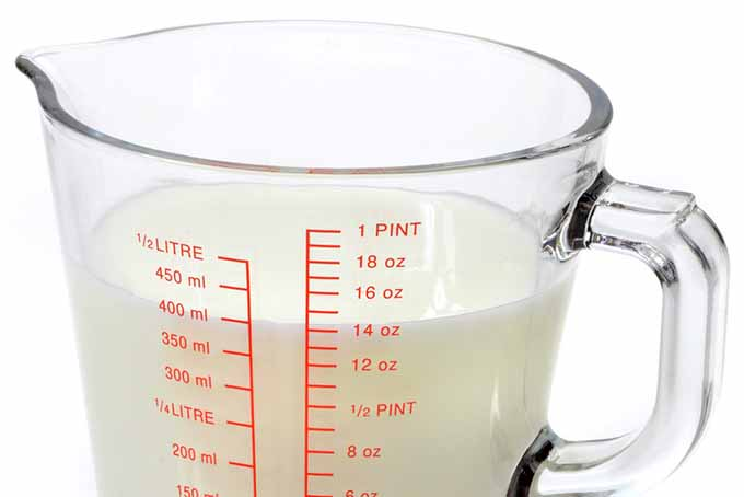 Measured Milk in Glass Measuring Cup | Foodal.com