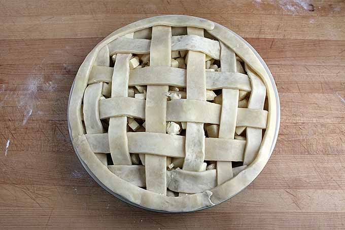 Top view of an upbaked apple pie with lattice top.